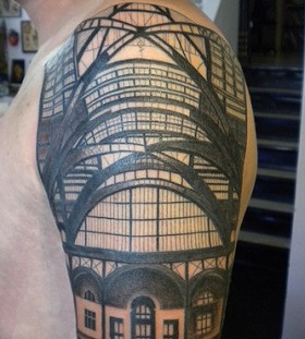 Men's shoulder's architecture tattoo