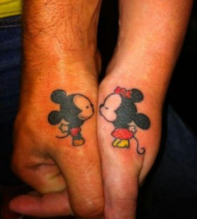 Mickey and Minnie thumb tattoos