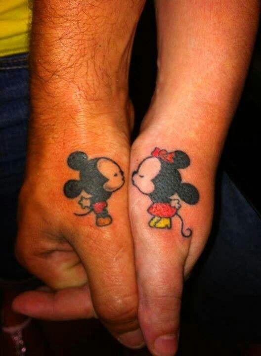 Mickey and Minnie thumb tattoos