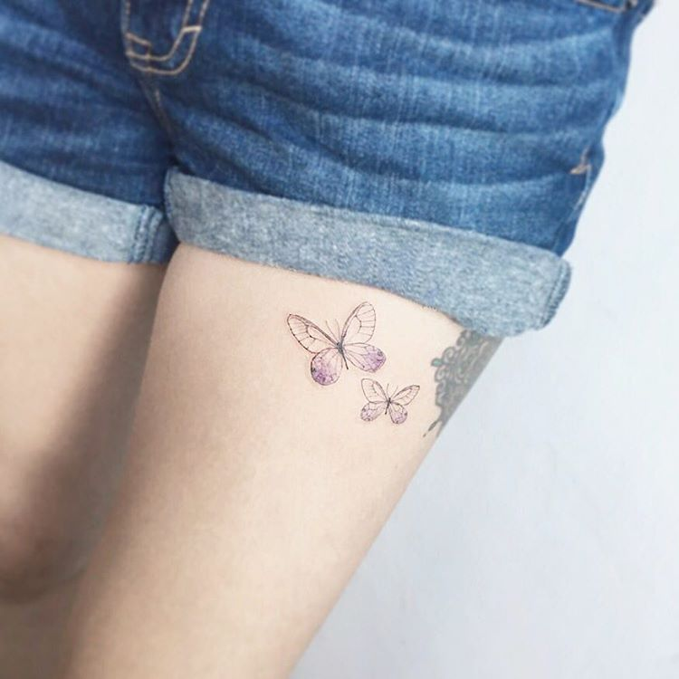 minimalistic-leg-thigh-butterflt-tattoos-by-tattooist_flower