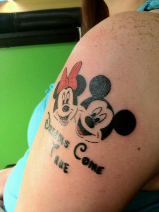 Minnie and Mickey and writing tattoo