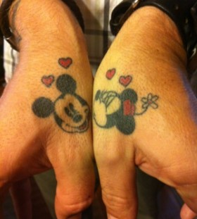 Minnie and Mickey thumb tattoos