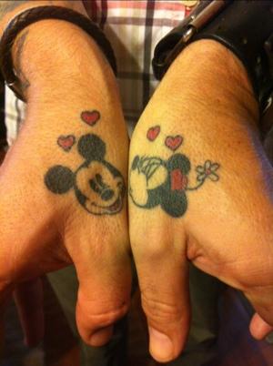 Minnie and Mickey thumb tattoos