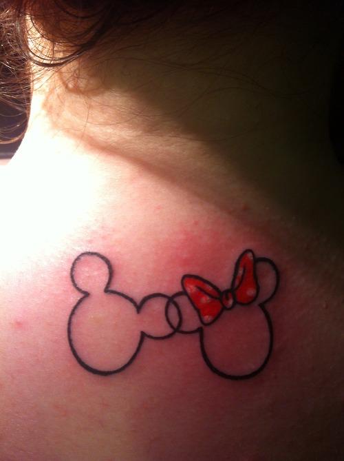 Minnie and Mickey's head tattoos