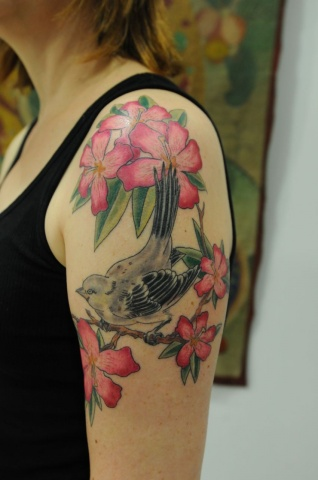 Mockingbird and flowers tattoo