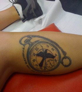 Mockingbird and watch tattoo