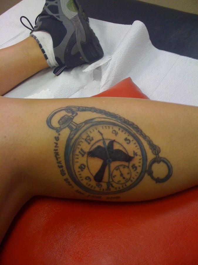 Mockingbird and watch tattoo