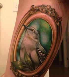 Mockingbird frame arm tattoo
