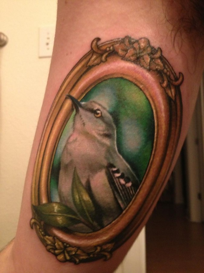Mockingbird frame arm tattoo