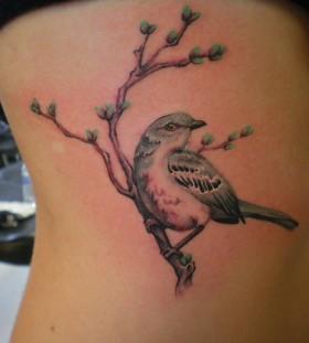 Mockingbird on a branch tattoo