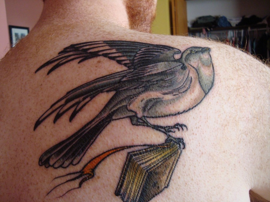 Mockingbird with a book tattoo