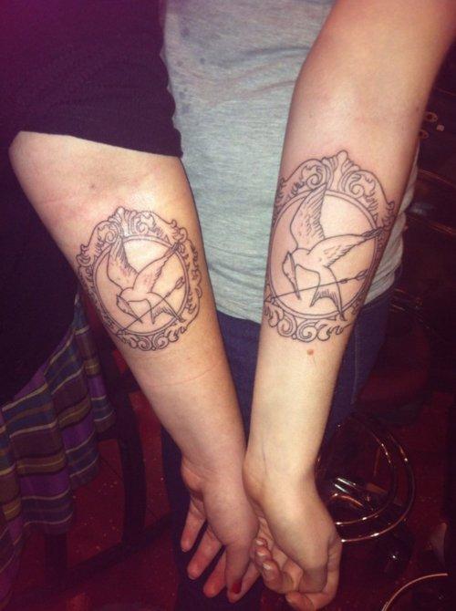 Mockingjay frame arm tattoo