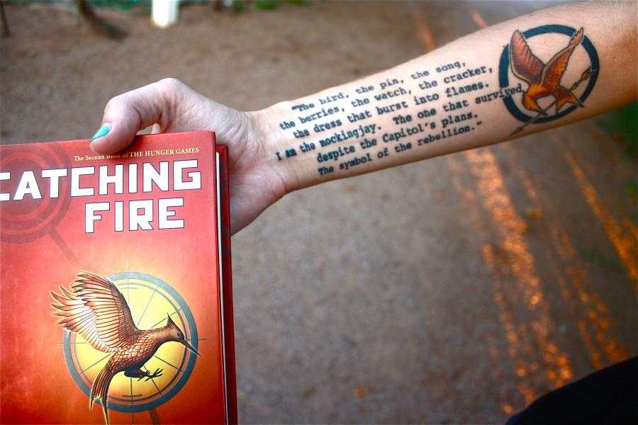 Mockingjay logo with quote tattoo