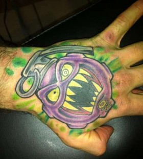 Monster face grenade tattoo