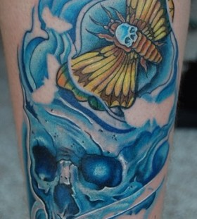 Moth and blue skull tattoo
