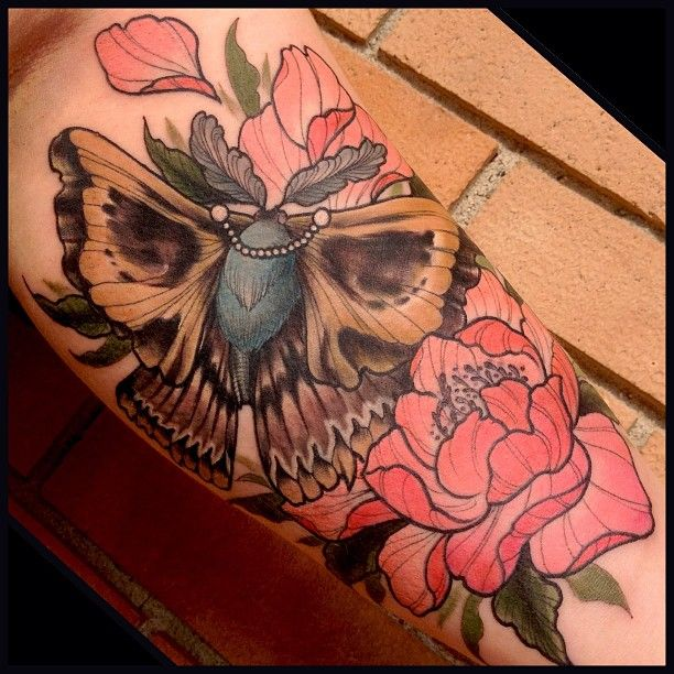Moth and flowers tattoo