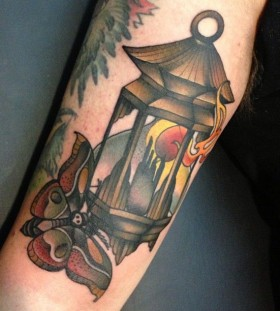 Moth and lantern tattoo by Amanda Leadman