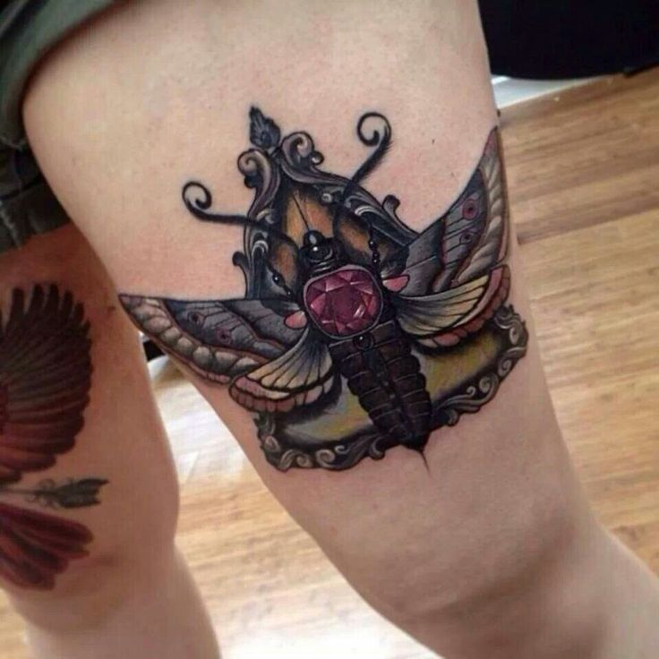 Moth with jewel tattoo