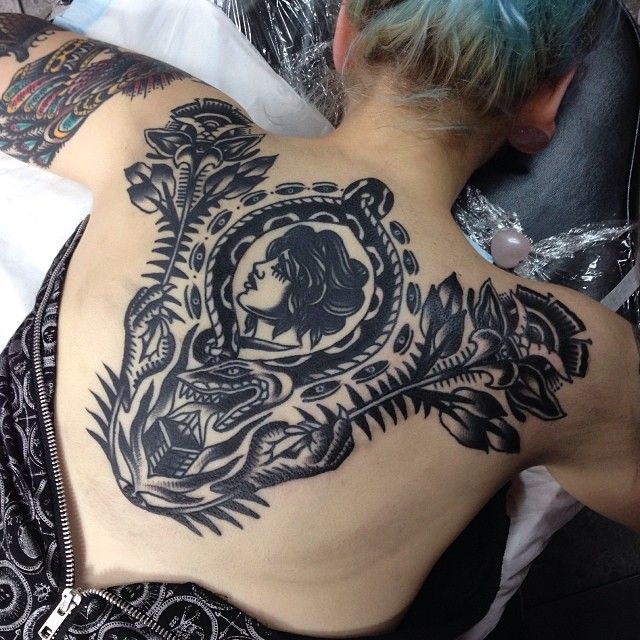 Nice back tattoo by James McKenna