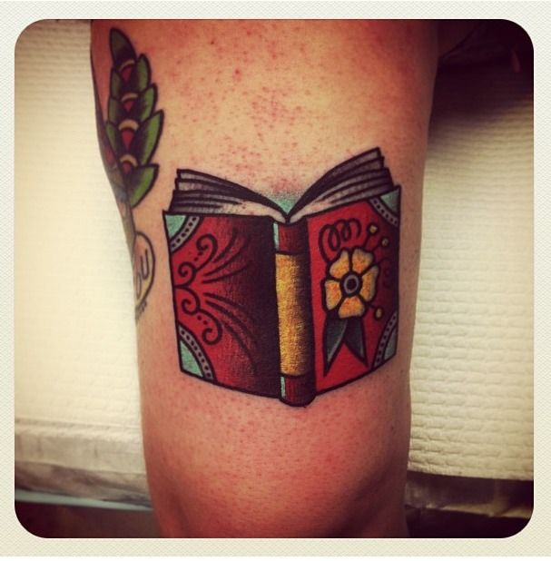 Nice book tattoo by Charley Gerardin