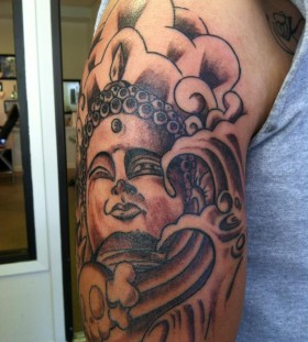 Nice buddha arm tattoo