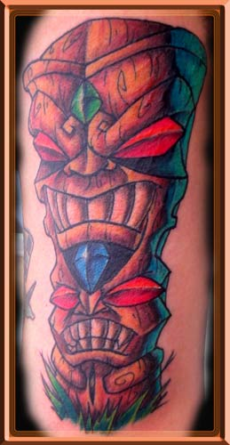 Nice double tiki tattoo