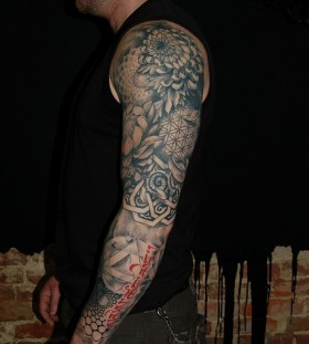 Nice full arm tattoo by David Allen