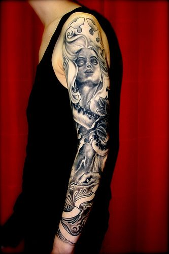 Nice full arm tattoo by Eva Huber