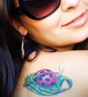 Nice ladybug and leaf tattoo