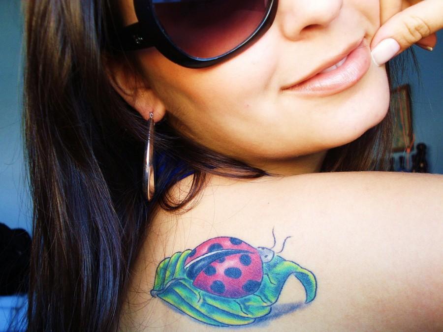 Nice ladybug and leaf tattoo