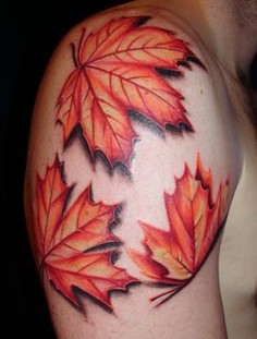 Nice maple leaves arm tattoo