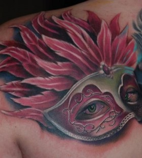 Nice mask tattoo by Kyle Cotterman
