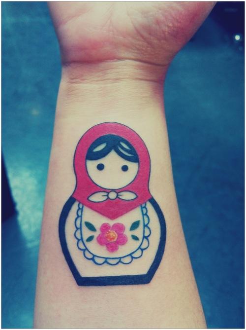 Nice matryoshka arm tattoo