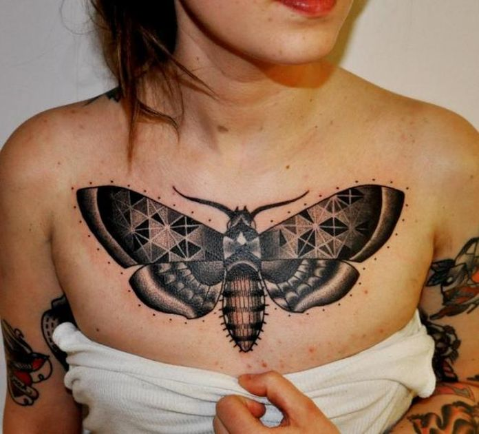 Nice moth chest tattoo