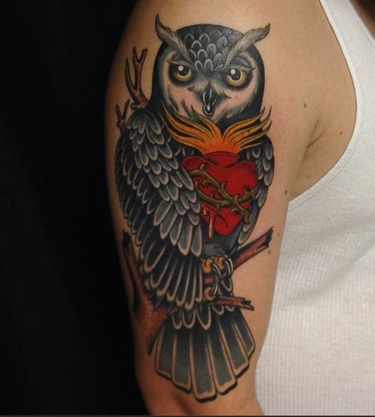 Nice owl arm tattoo