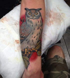 Nice owl tattoo by Dan Molloy