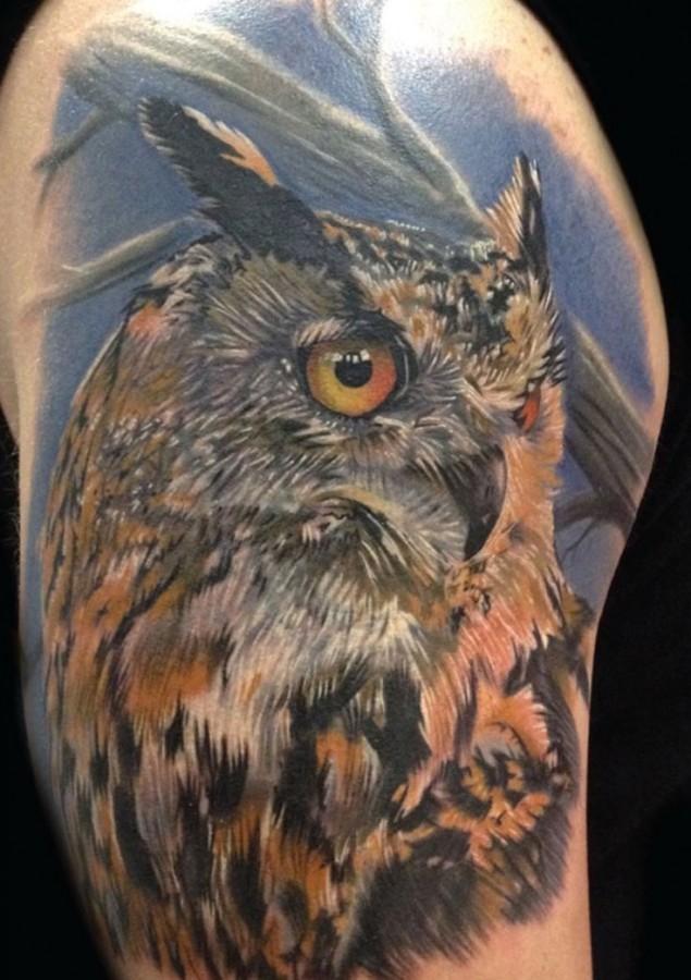 Nice owl tattoo by Phil Garcia