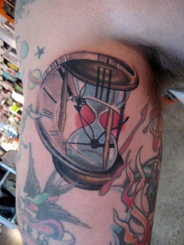 Nice sand clock tattoo