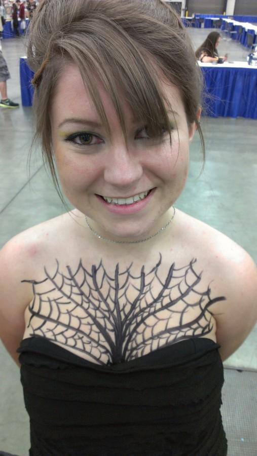 Nice spider web chest tattoo