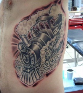 Nice steaming train side tattoo