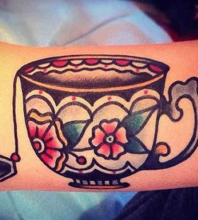 Nice teacup arm tattoo
