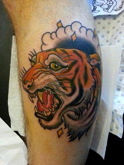 Nice tiger tattoo by Drew Shallis