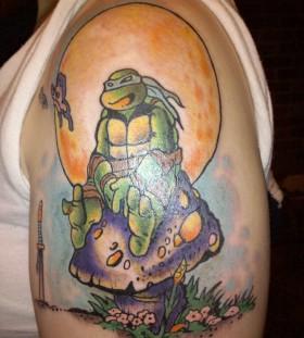 Ninja turtle sitting on mushroom tattoo