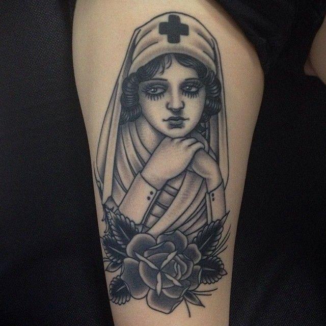 Nurse and flowers tattoo