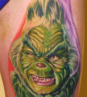 Old and angry looking grinch christmas tattoo