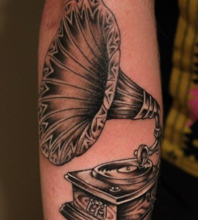 Old gramophone arm tattoo