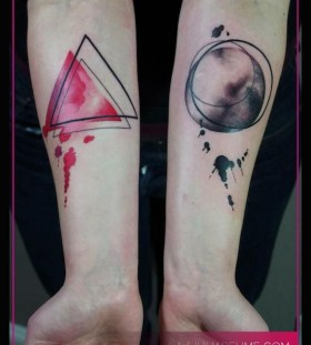Owal black and red triangle tattoo