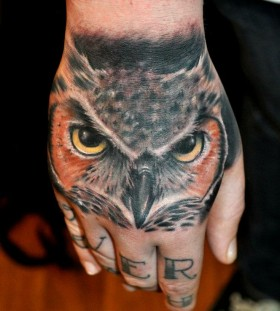 Owl hand tattoo by Benjamin Laukis