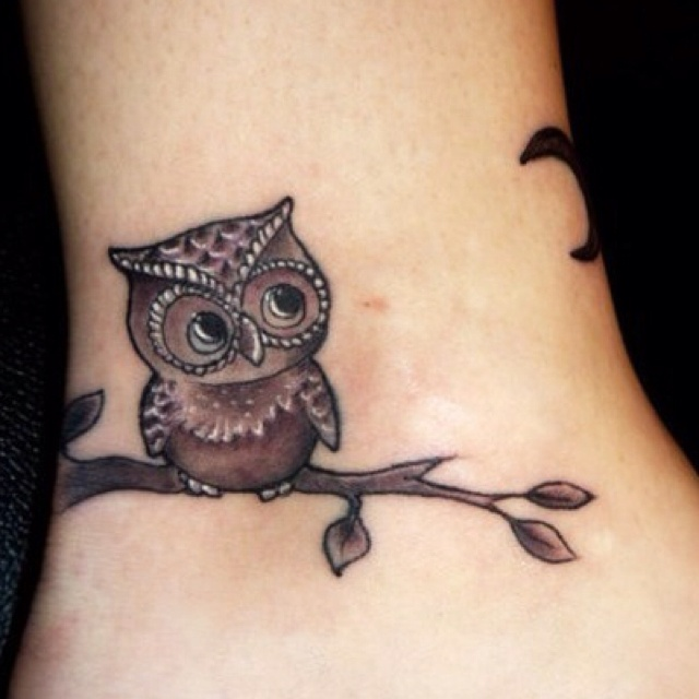 Owl on a branch tattoo