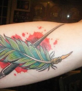 Paint brush and feather tattoo